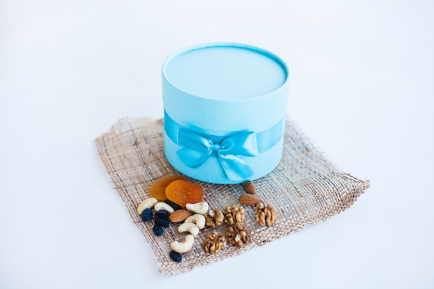 Box with nuts and dried fruits, healthy snack, proper nutrition