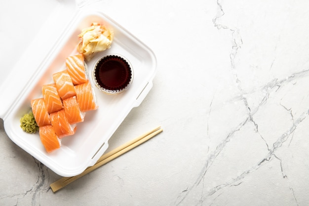 Box with rolls cream cheese soy sauce and wasabi. japanese kitchen. food delivery.