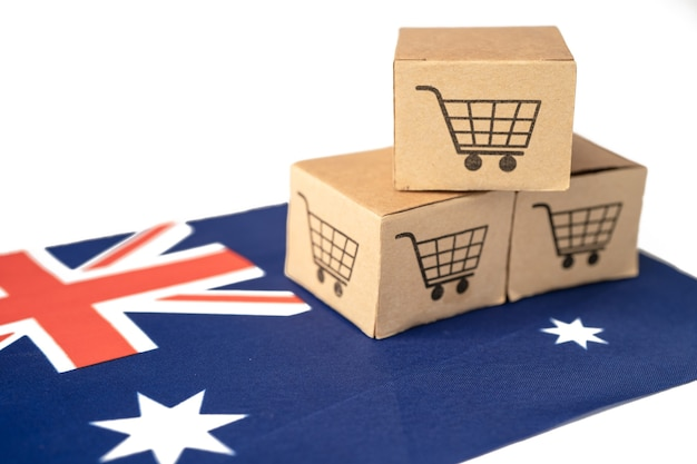 Box with shopping cart logo and australia flag, import export shopping online or ecommerce finance