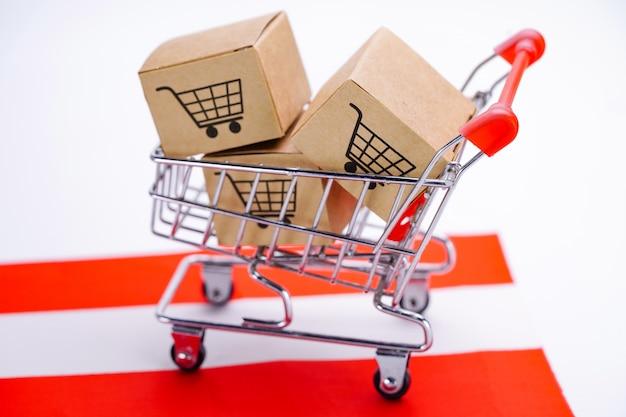 Box with shopping cart logo and austria flag.