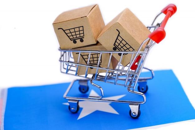 Box with shopping cart logo and somalia flag.