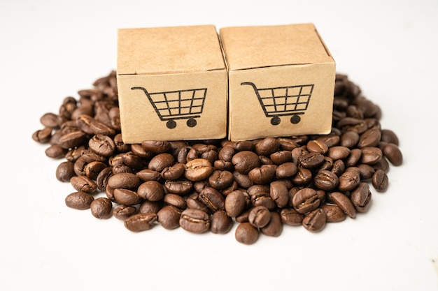Box with shopping cart logo symbol on coffee beans, import export shopping online or ecommerce delivery service store product shipping, trade, supplier concept.