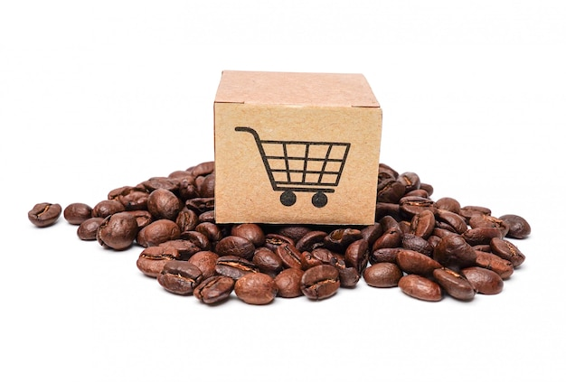 Box with shopping cart logo symbol on coffee beans.
