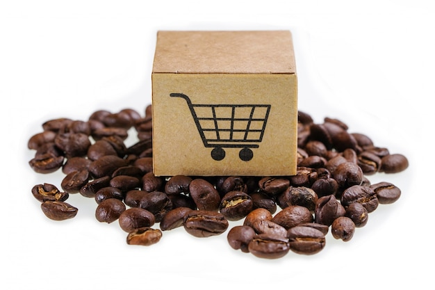 Box with shopping cart logo symbol on coffee beans
