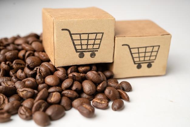커피 콩, 수입 수출 쇼핑 온라인 또는 전자 상거래 배달 서비스 상점 제품 배송, 무역, 공급 업체 개념에 쇼핑 카트 로고 기호가있는 상자. 프리미엄 사진