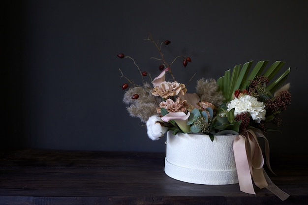 A box with a vintage bouquet on a dark background