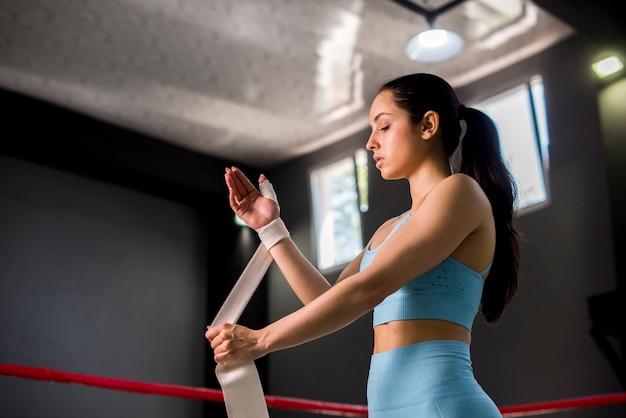 Boxer girl posing at the gym