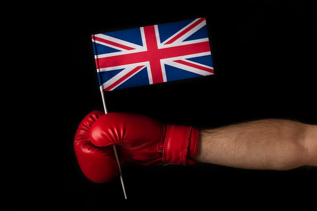 Boxer hand holds flag of great britain