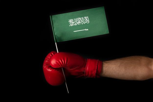 Boxer hand holds flag of saudi arabia