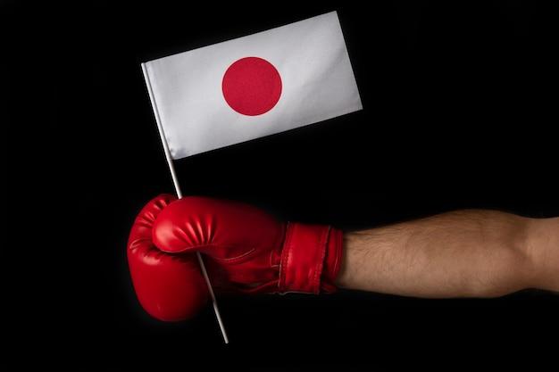 Boxer holds flag of japan