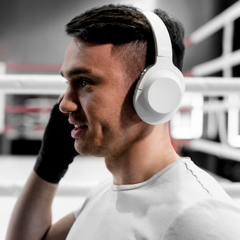 Boxer male with headphones