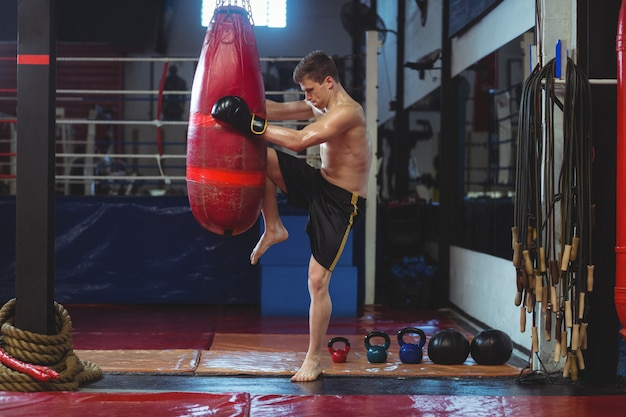 Boxer practicing boxing with punching bag