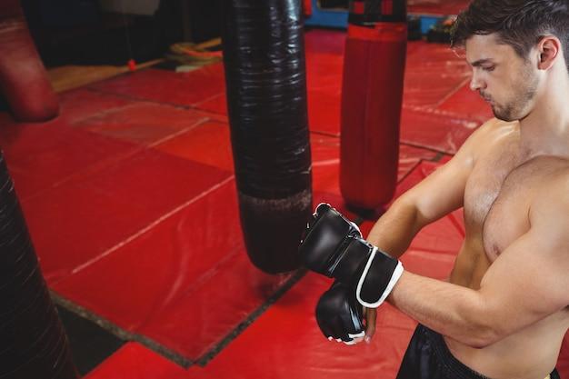 Boxer wearing grappling gloves
