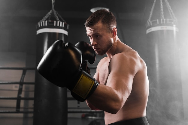 Boxer with black gloves training