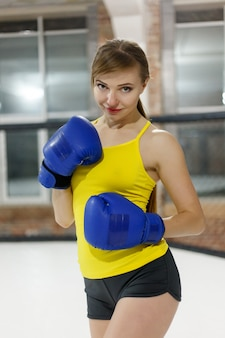 Boxer woman with blue gloves training