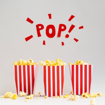 Boxes of popcorn on gray background