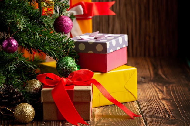 Boxes of present with christmas ornament on wooden background