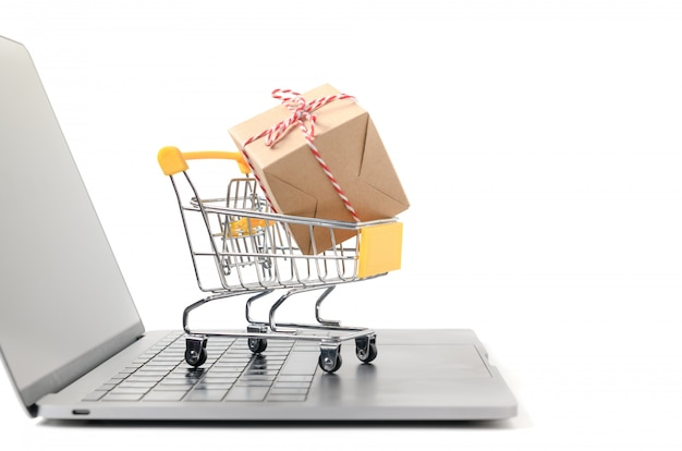 Boxes in a trolley on a laptop keyboard isolated