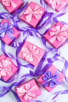 Boxes with gifts for  holiday birthday christmas valentine's day pink on white background top view