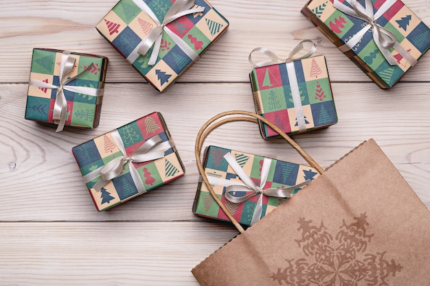 Boxes with gifts in holiday paper, on a wooden package. the concept of winter holidays.