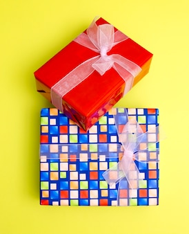 Boxes with gifts and surprises on a yellow