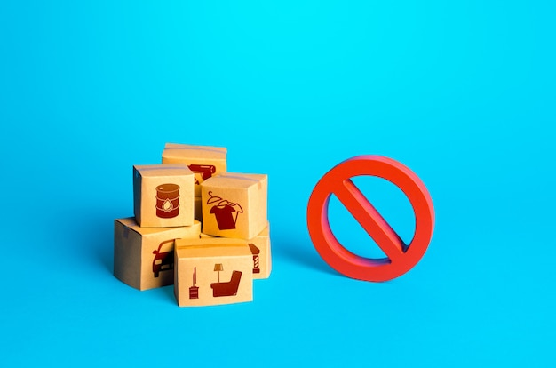 Boxes with goods and a red prohibition sign no restrictions on import of products