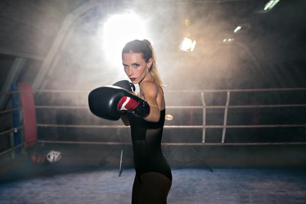 Boxing blonde sportswoman on ring