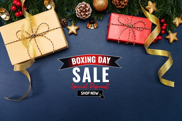 Boxing day sale with christmas present and xmas decoration on blue
