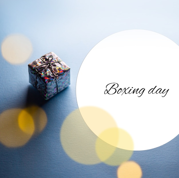 Boxing day a small gift in a package beautiful box poster boxing day flyer box with ribbon
