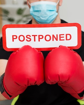 Boxing event postponed message