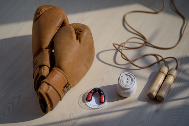 Boxing gear on a wooden surface