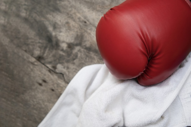 Boxing glove with towel on awooden surface