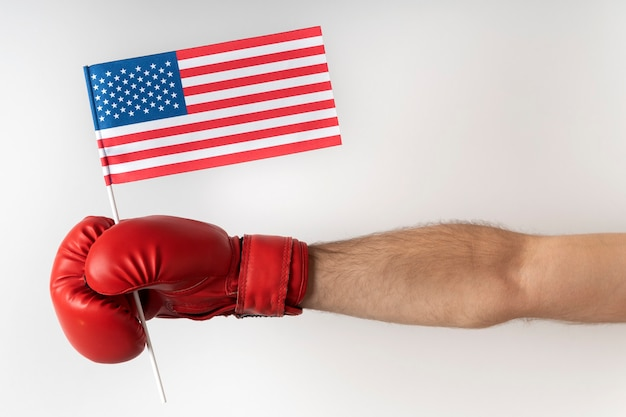 Boxing glove with usa flag. boxer holds flag of united states. white surface.