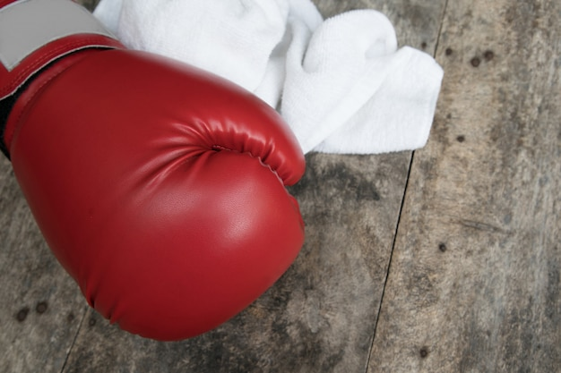 Boxing glove on a wooden surface