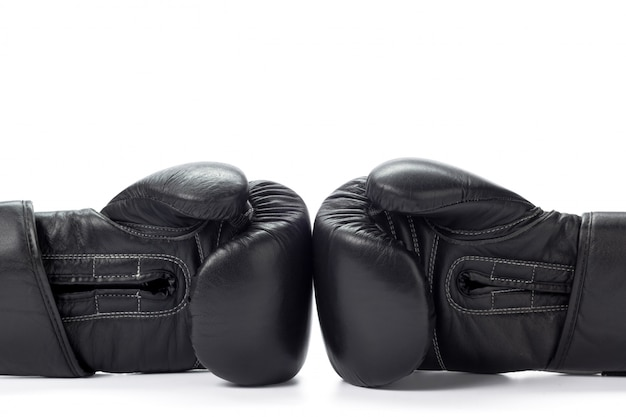 Boxing gloves close up on white
