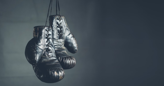 Boxing gloves on the dark background