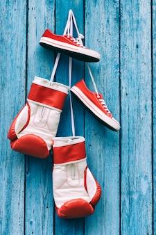 Boxing gloves and shoes hanging on the wall