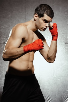 Boxing male ready to attack