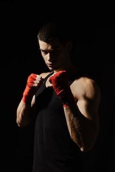 Boxing male standing in a rack