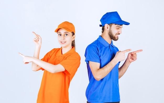 파란색과 노란색 유니폼을 입은 소년과 소녀는 왼쪽과 오른쪽에 무언가를 제시합니다.