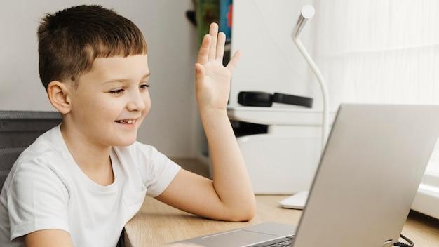 Boy attending an online course