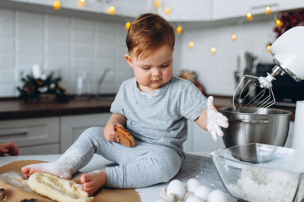 Boy bakes cookies in the kitchen