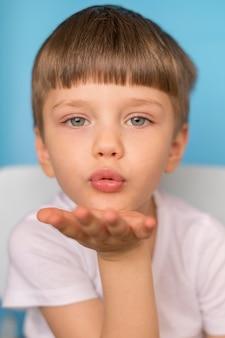 Boy blowing kiss