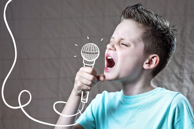 Boy in a blue t-shirt sings very loudly into a painted microphone
