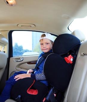 Boy in car safety seat