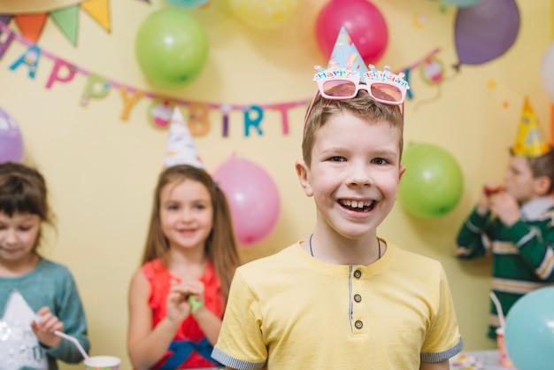 Boy celebrating birthday with friends