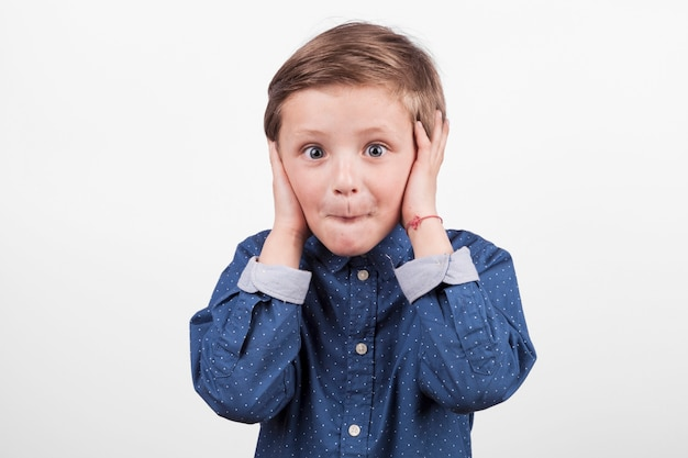 Boy covering ears