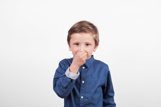 Boy covering nose
