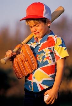 Boy crying over baseball game