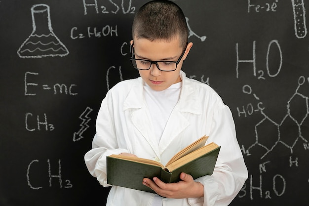 Boy doing experiments in laboratory